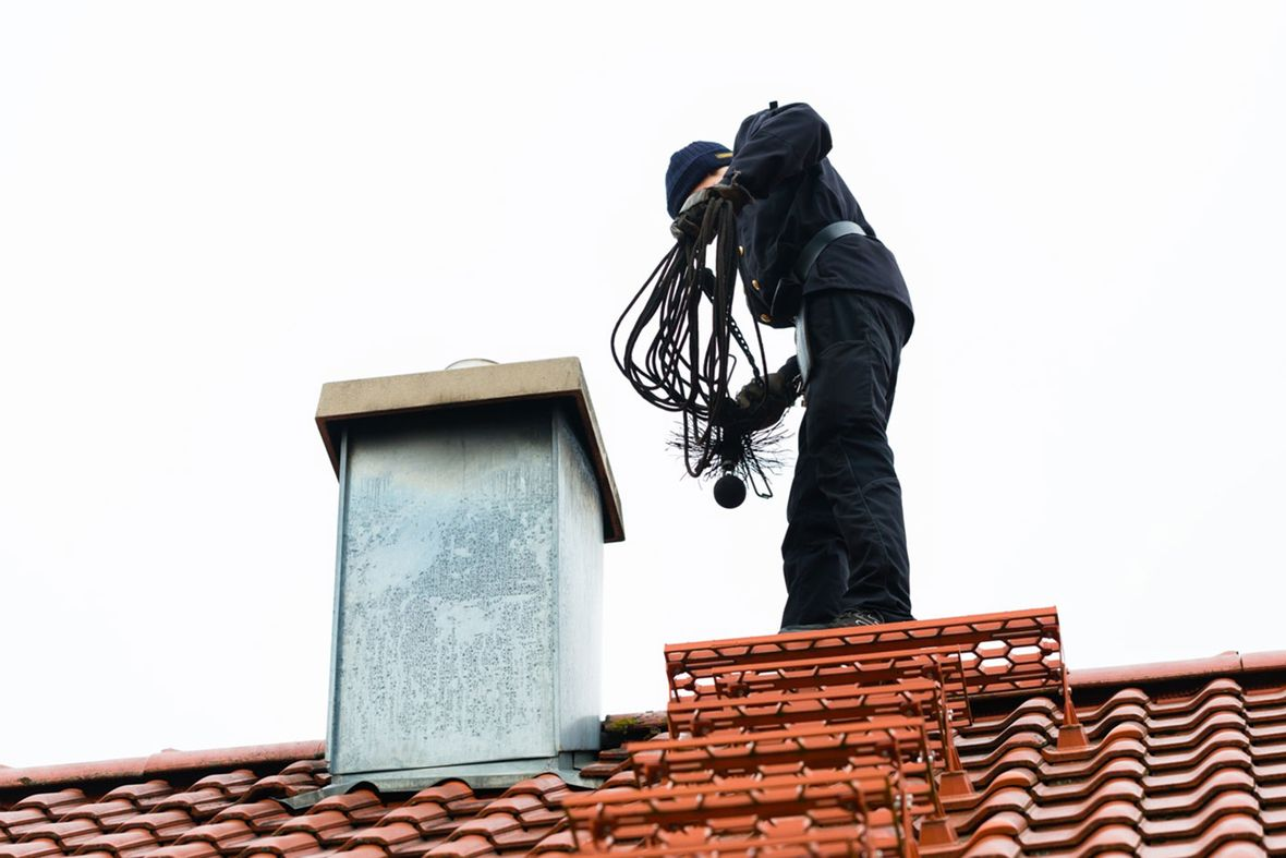 a chimney sweep on top of a roof